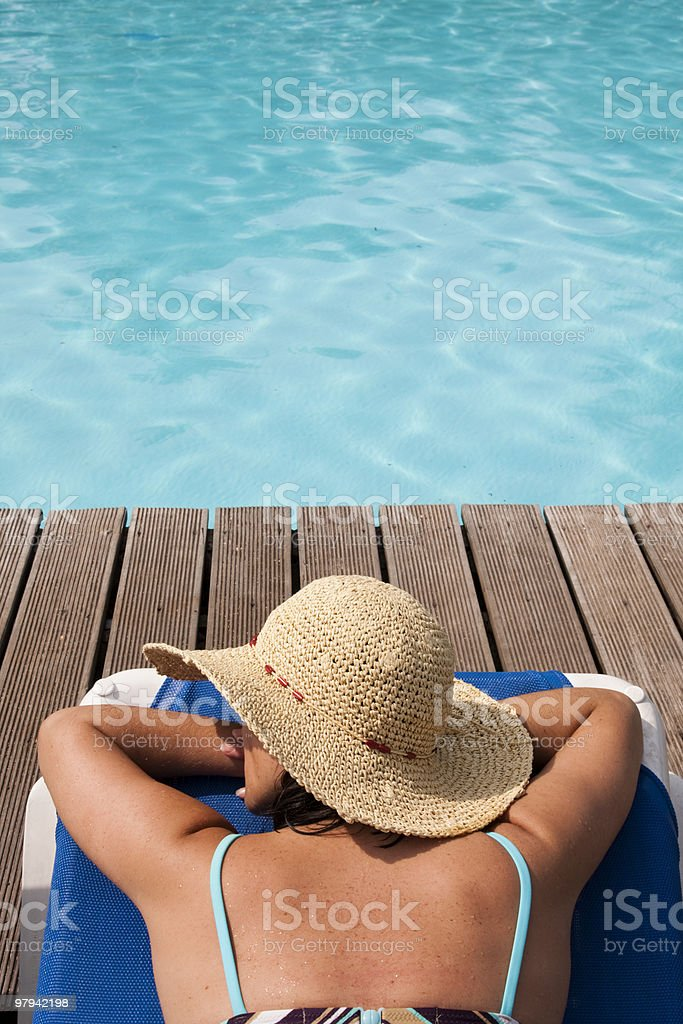 relaxing at the pool royalty-free stock photo