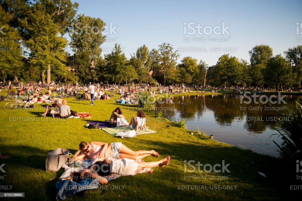 Relaxing at Vondelpark lake stock photo