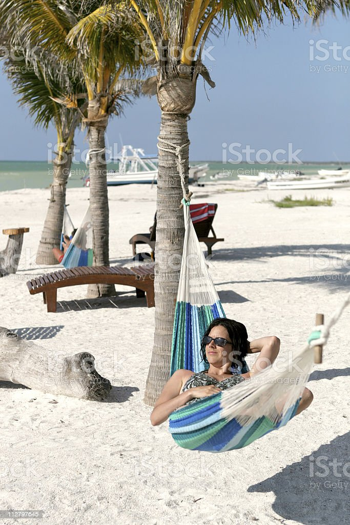Relaxing Beautiful Young Woman In Hammock on Tropical Beach Paradise royalty-free stock photo