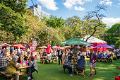 Edinburgh, Scotland, UK - People relaxing between Edinburgh Festival Fringe shows in George Square Gardens.