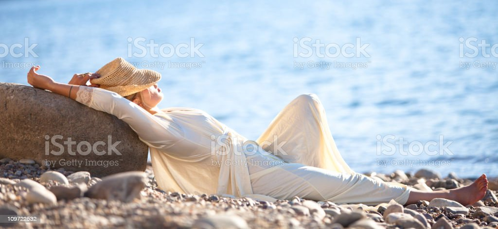 Relaxing by the shore stock photo