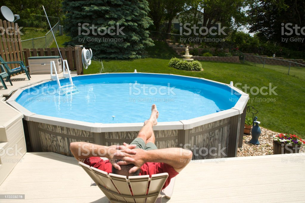 Relaxing by the Swimming Pool royalty-free stock photo