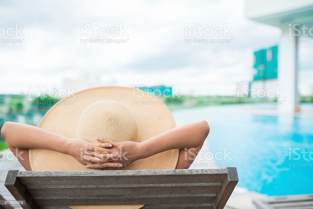 Relaxing by the swimming pool stock photo