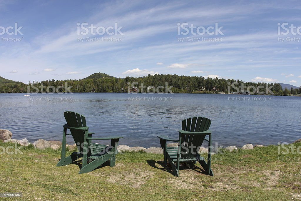 relaxing chairs by the lake royalty-free stock photo