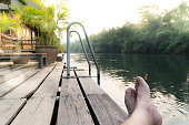 relaxing day at river Kwai view at rafting cottage terrace on sunset