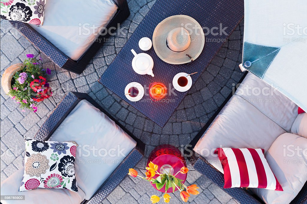 Relaxing evening on the patio having tea stock photo