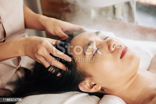 istock Relaxing head massage 1188324706