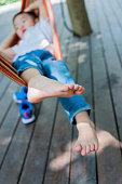 Little boy relaxing in a hammock.