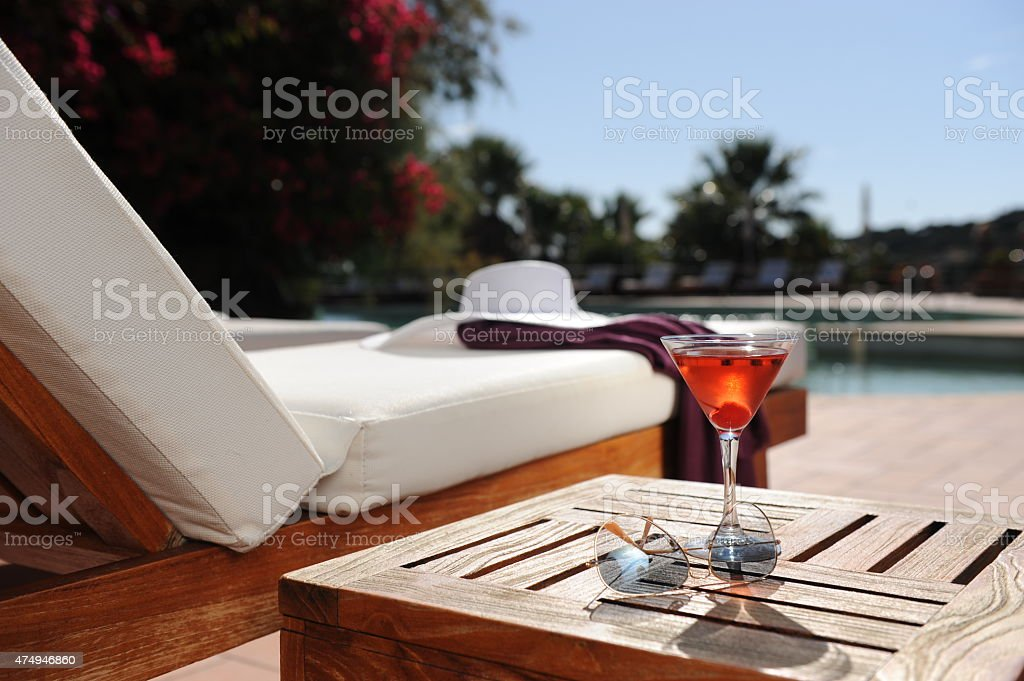 relaxing in a luxury hotel by the pool stock photo