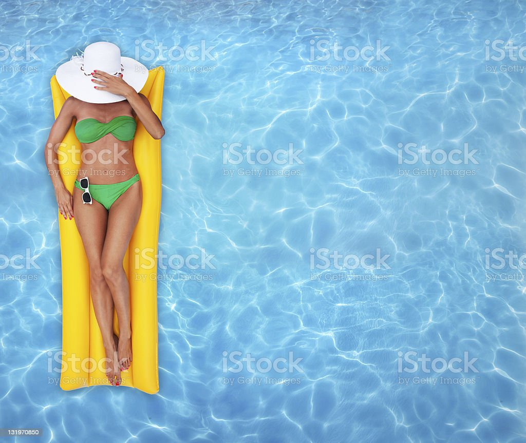 Relaxing in a pool stock photo