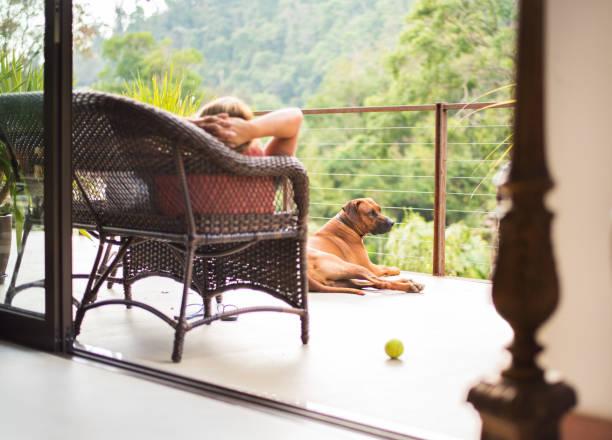 Relaxing in balcony stock photo