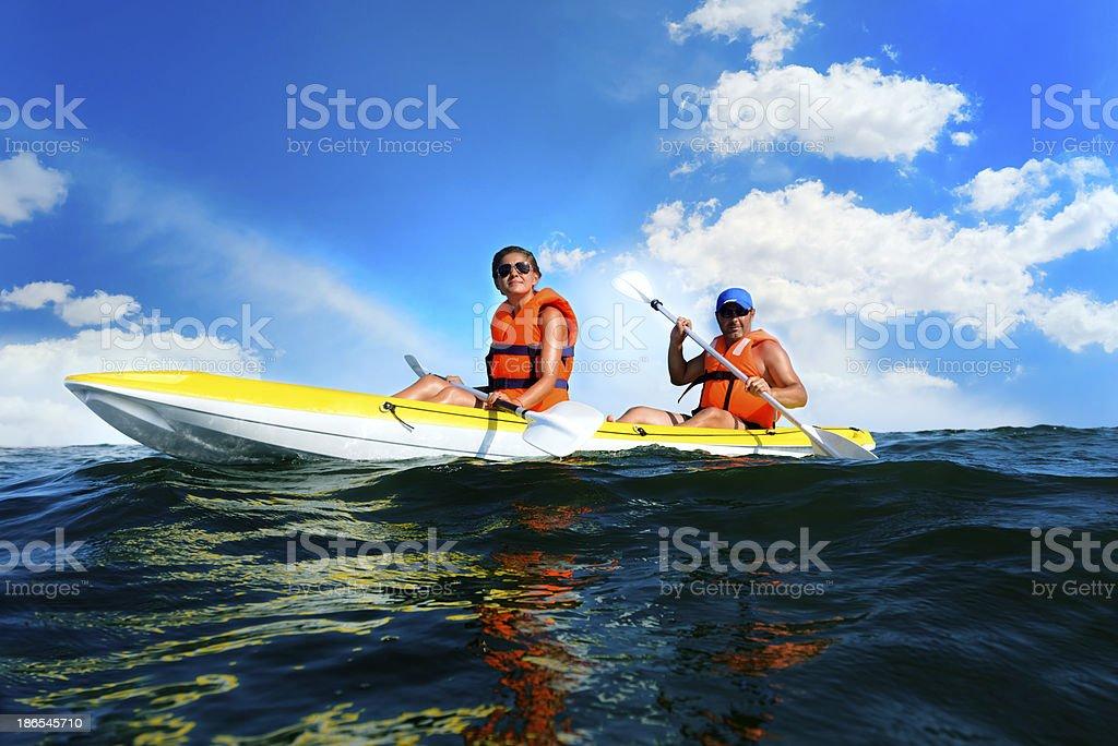 relaxing in canoe stock photo