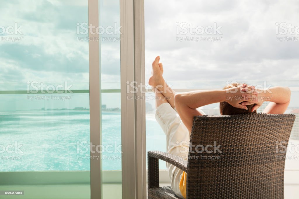 Relaxing in Hotel Balcony with Scenic Beach and Sea Views stock photo