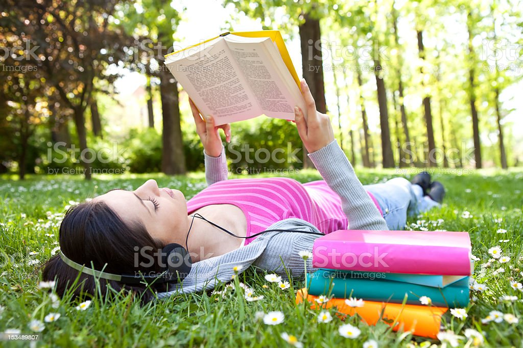 relaxing in nature with book and music stock photo