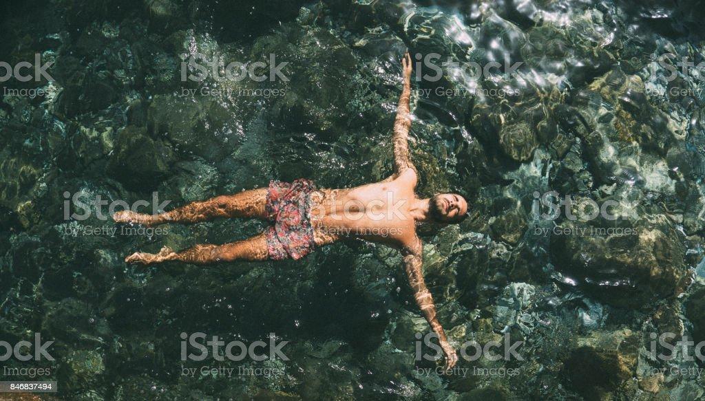 Relaxing in sea water stock photo
