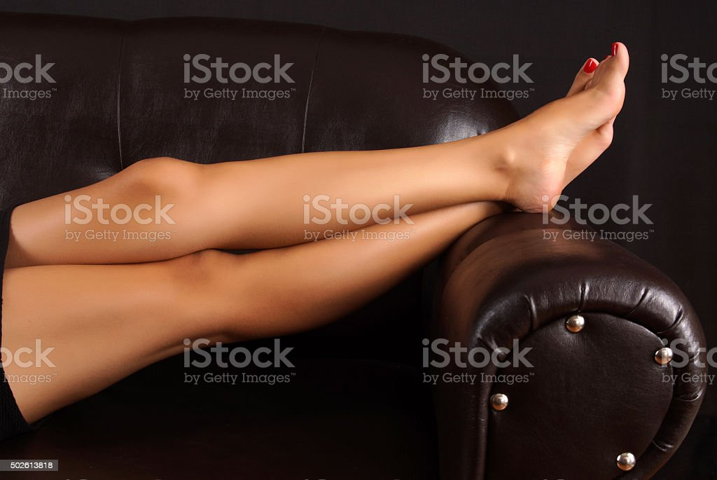 Relaxing in sofa stock photo