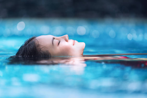 Relaxing in swimming pool. stock photo