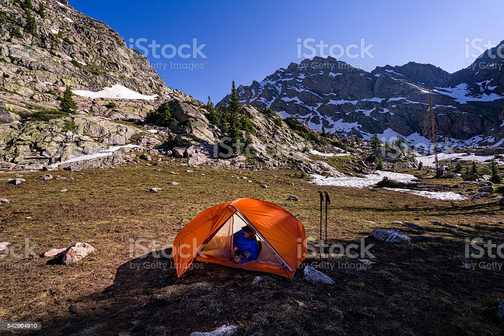 Relaxing in Tent Drinking Beverage stock photo