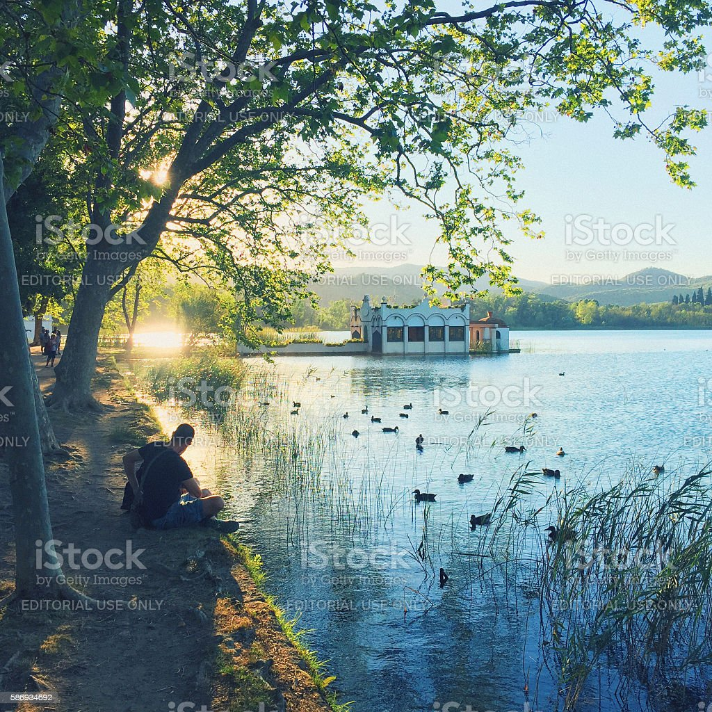 Relaxing in the lake at sunset stock photo