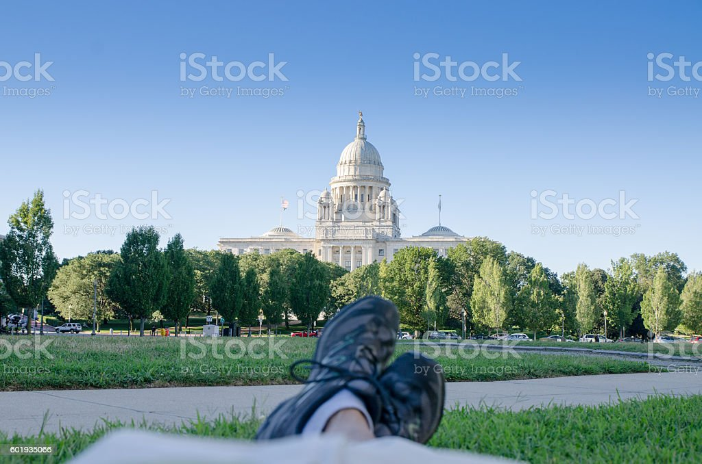 Relaxing in the park in front of Providence State House stock photo