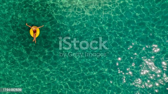 Photo of a woman relaxing in the sea, sitting on a inflatable ring