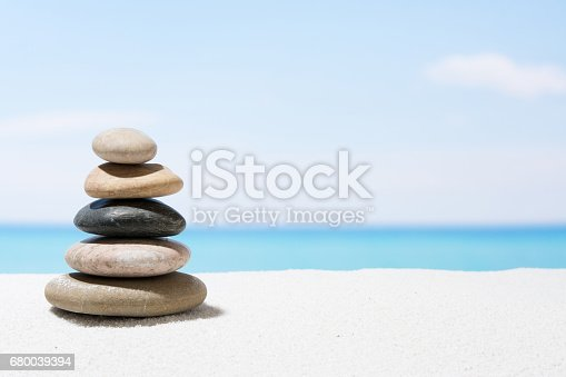 istock Relaxing in the tropical beach, with white sand and stack of stones 680039394