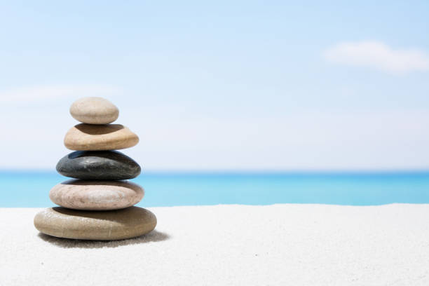 Relaxing in the tropical beach, with white sand and stack of stones stock photo