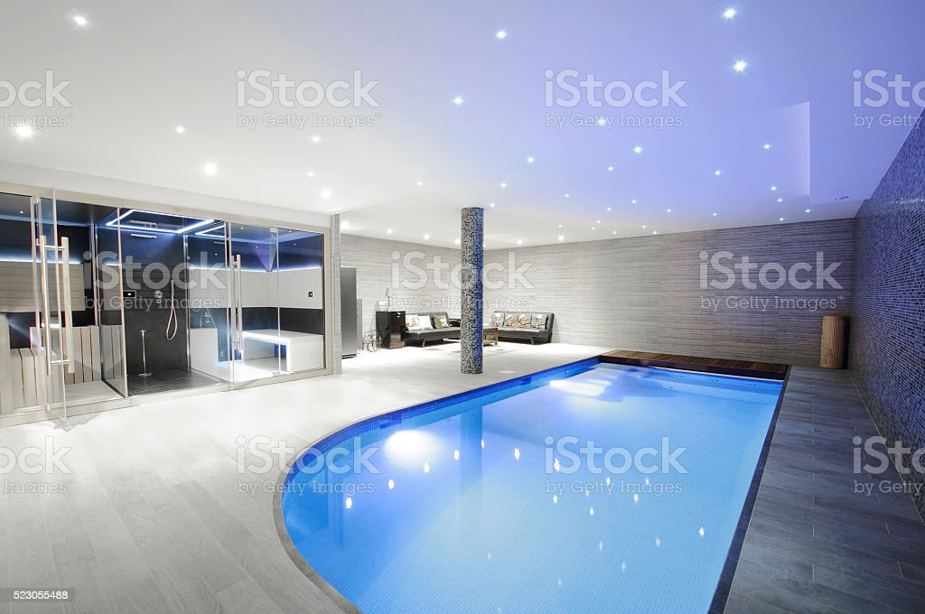 Relaxing indoor swimming pool with lighting stock photo
