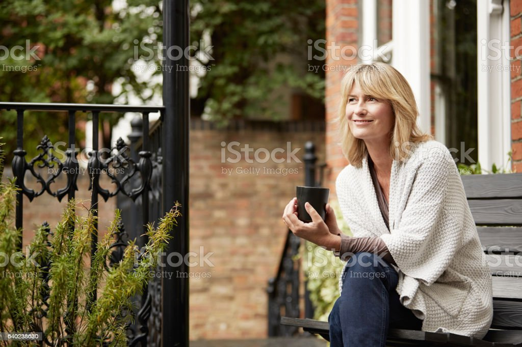 Relaxing into the day with a cup of coffee stock photo
