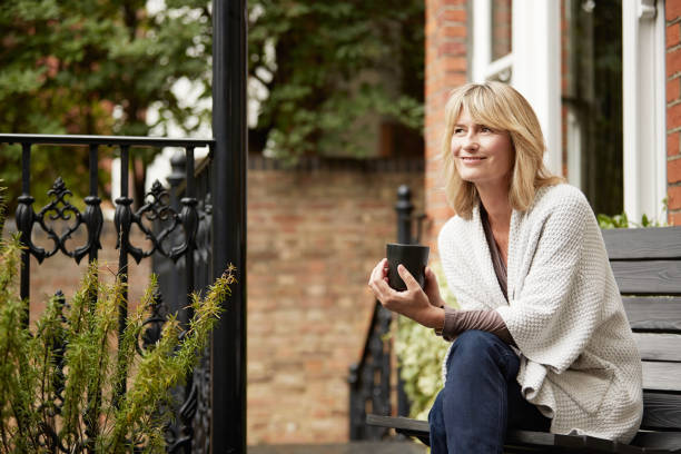 relaxing into the day with a cup of coffee - memorial day fotografías e imágenes de stock
