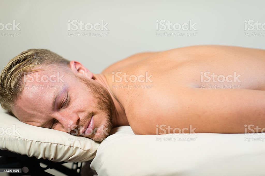 Relaxing Massage Client stock photo