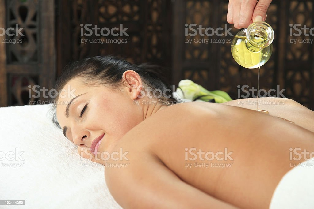 Relaxing massage with massager oil royalty-free stock photo