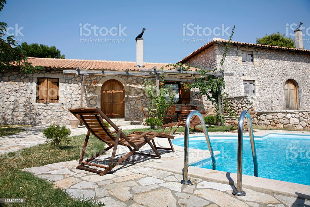 A relaxing Mediterrannean villa with a lovely pool royalty-free stock photo