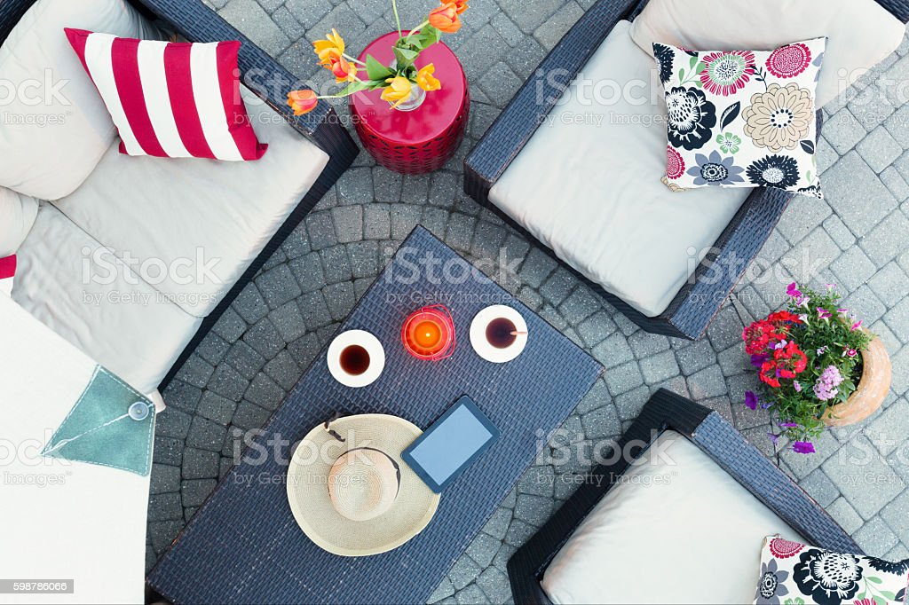 Relaxing on a brick patio by candlelight stock photo