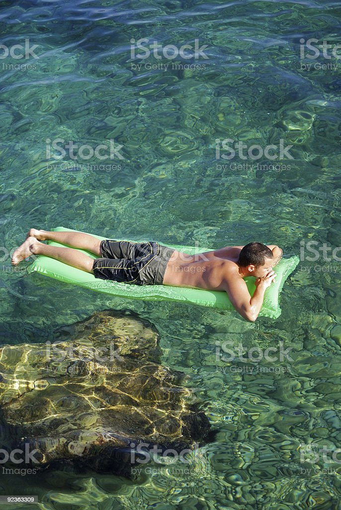 Relaxing on a Lilo royalty-free stock photo