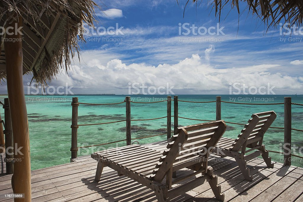 Relaxing on an over water tropical bungalow stock photo