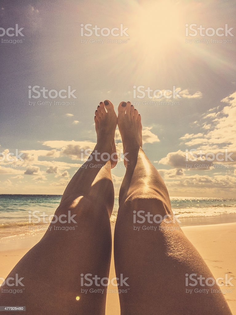 Relaxing on idyllic beach, Bermuda stock photo