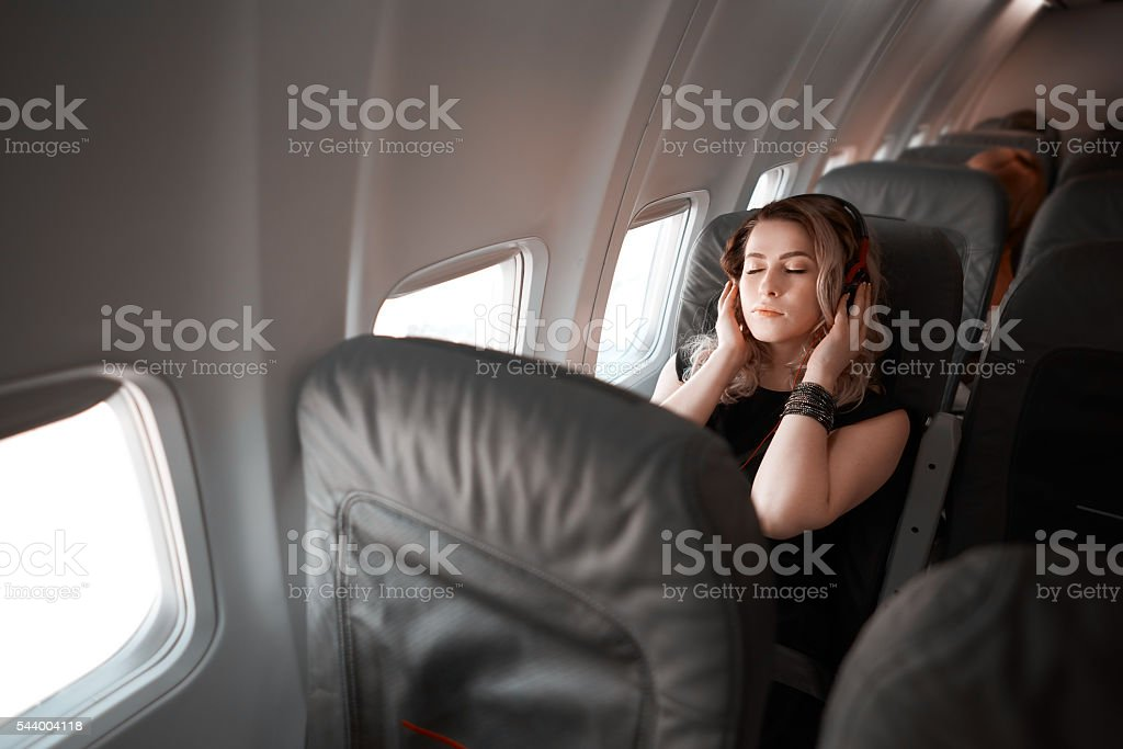 relaxing on my flight with good music stock photo