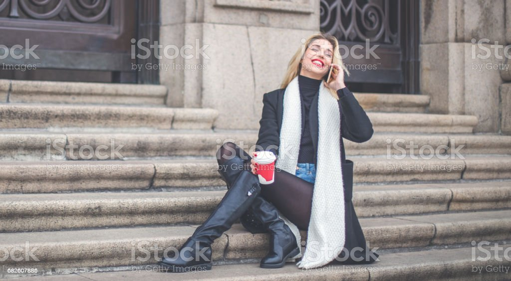 Relaxing on steps stock photo