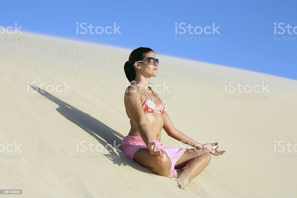 relaxing on the sand dune royalty-free stock photo