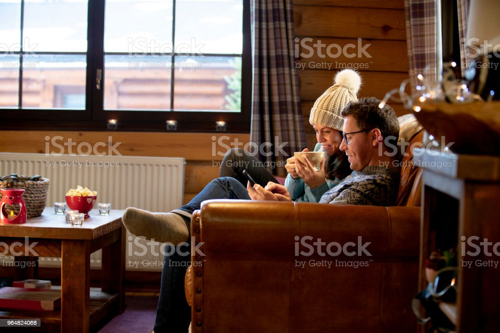 Relaxing on the Sofa with his Wife royalty-free stock photo
