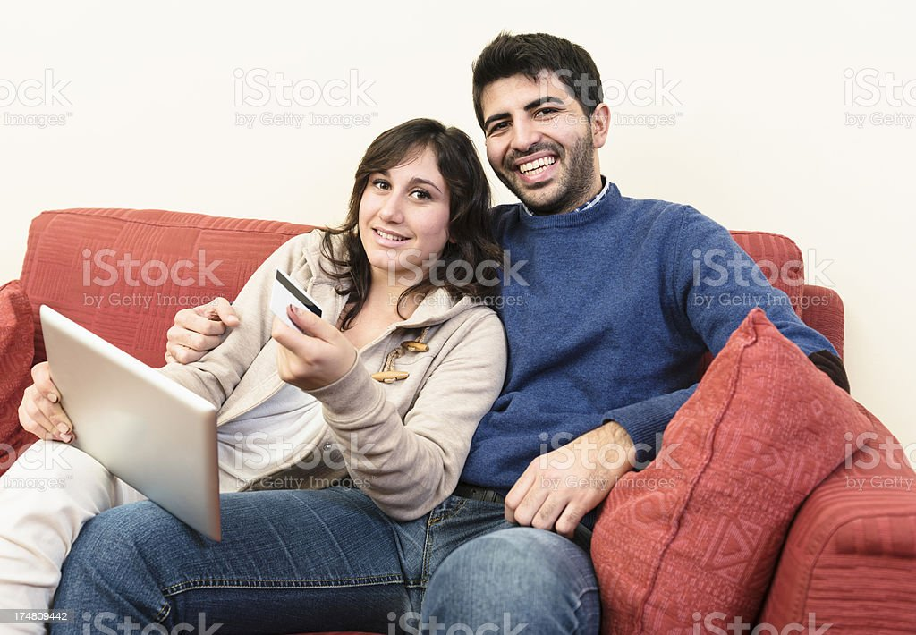 Relaxing on the sofa with tablet royalty-free stock photo
