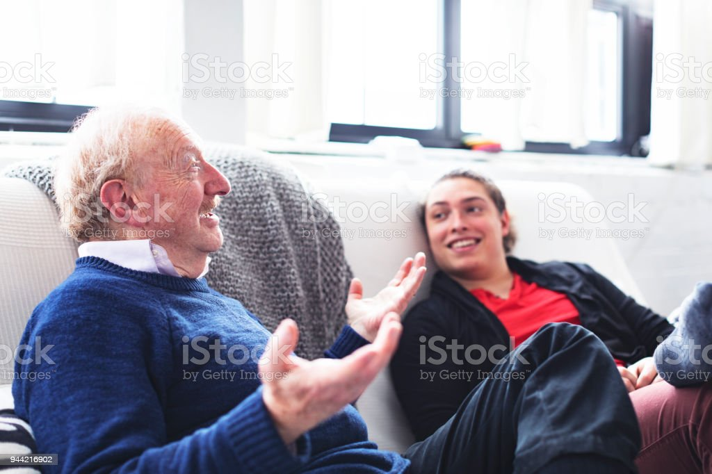 Relaxing On The Weekend Enjoying A Conversation With Your Father
