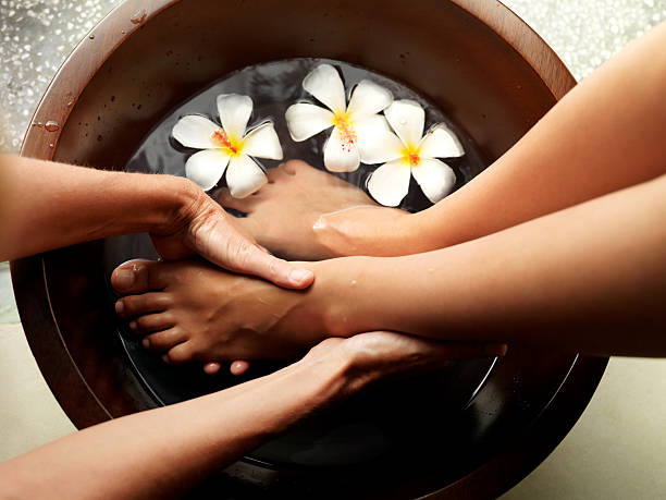 relaxing pedicure - spa treatment stock photos and pictures