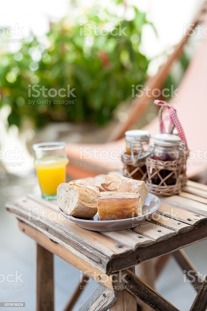 relaxing scene of chair and continental breakfast stock photo