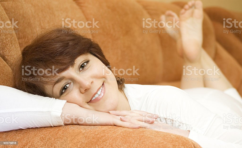 Relaxing smiling young woman in white dress royalty-free stock photo