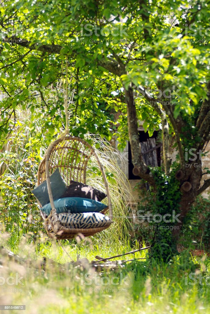 Relaxing spot in the garden with swing stock photo