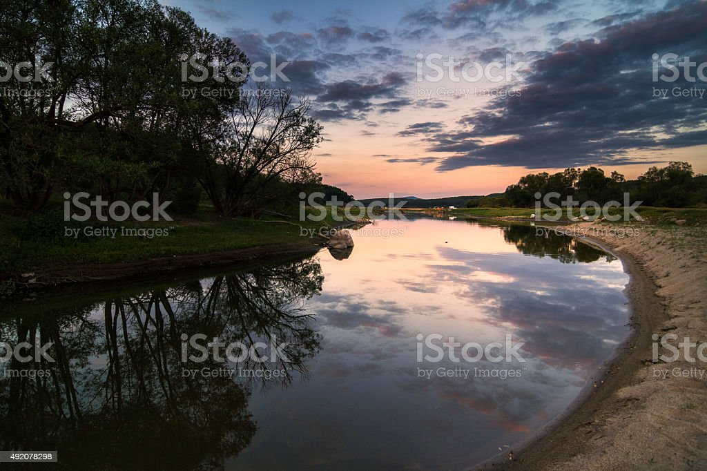 Relaxing summer river sunset stock photo