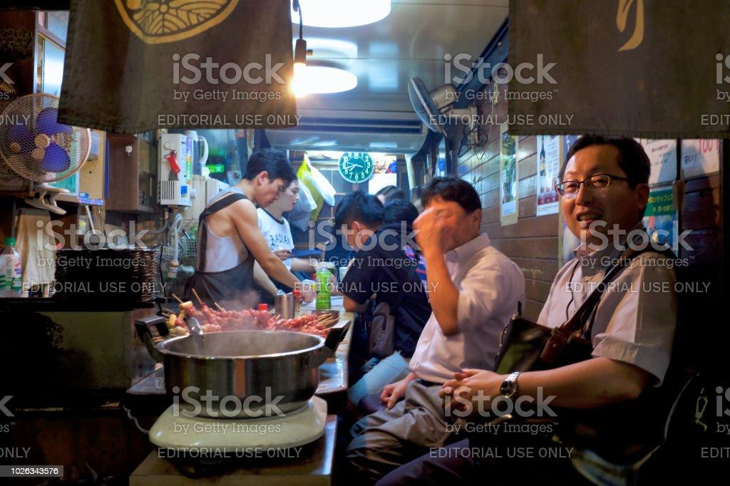Relaxing time of Omoide Yokocho Street stock photo