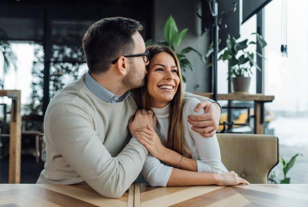 relaxing time. - brunette woman eyeglasses kiss man foto e immagini stock